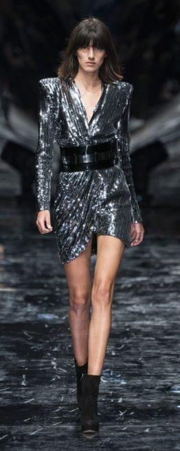 <p><strong>Azzaro - أزارو </strong></p> <p>انوثة طاغية تألقي بها هذا الشتاء في السهرات والمناسبات المختلفة مع هذا الفستان القصير باللون الفضّي البراق المزين بالحزام الاسود العريض.</p>