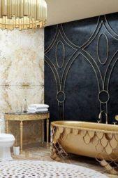 <strong></strong>إختاري مغطساً ذهبياً بتصميم مبتكر للحمّام الرئيسي مع طاولة رخامية فخمة وثريا ملفتة باللون عينه، واحرصي على زخرفة الجدار الأسود برسومات ذهبية متناسقة.