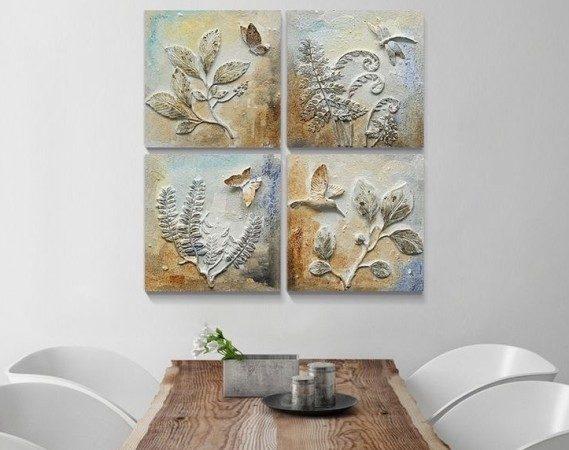 إختاري مجموعة من اللوحات الجدارية المنحوتة والملونة بطريقة متناسقة وثبتيها بشكل أنيق على أحد جدران غرفة طعامك.